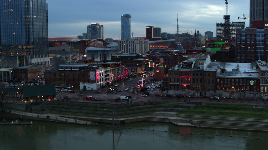 5.7K stock footage aerial video of flying by Broadway during ascent at twilight, Downtown Nashville, Tennessee Aerial Stock Footage | DX0002_120_020