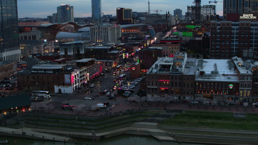 5.7K stock footage aerial video of flying by Broadway at twilight, Downtown Nashville, Tennessee Aerial Stock Footage | DX0002_120_021