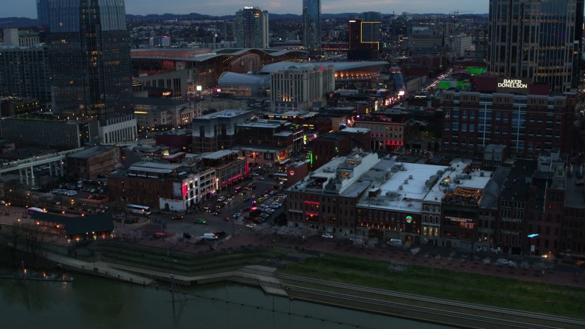 5.7K stock footage aerial video of a reverse view of Broadway during ascent at twilight, Downtown Nashville, Tennessee Aerial Stock Footage | DX0002_120_022
