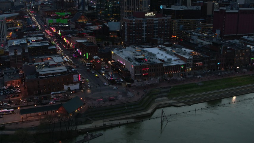 5.7K stock footage aerial video of buildings, cars and pedestrians around Broadway at twilight, Downtown Nashville, Tennessee Aerial Stock Footage | DX0002_120_026