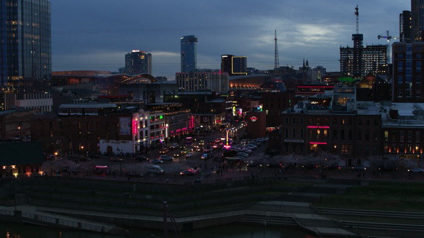 5.7K stock footage aerial video descend and flyby traffic and riverfront buildings on Broadway at twilight, Downtown Nashville, Tennessee Aerial Stock Footage | DX0002_120_033