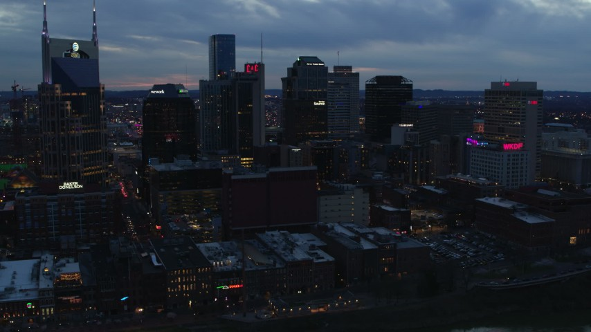 5.7K stock footage aerial video flying by the AT&T Building and tall skyscrapers at twilight, Downtown Nashville, Tennessee Aerial Stock Footage | DX0002_120_036