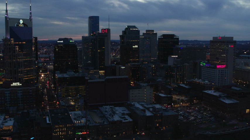 5.7K stock footage aerial video reverse view of a group of skyscrapers at twilight, reveal AT&T Building, Downtown Nashville, Tennessee Aerial Stock Footage | DX0002_120_038