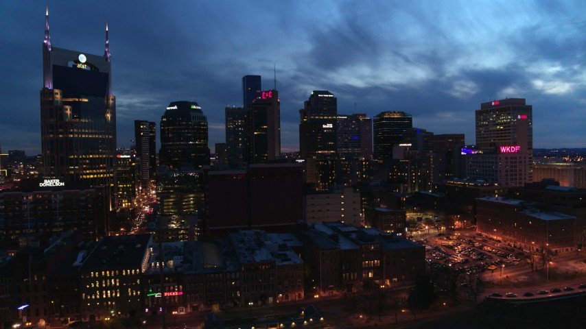 5.7K stock footage aerial video of passing by the city's skyline at twilight, Downtown Nashville, Tennessee Aerial Stock Footage | DX0002_121_002