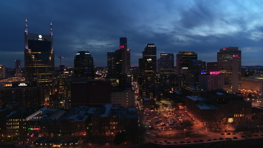 5.7K stock footage aerial video of flying away from the city's skyline at twilight, seen from Cumberland River, Downtown Nashville, Tennessee Aerial Stock Footage | DX0002_121_003