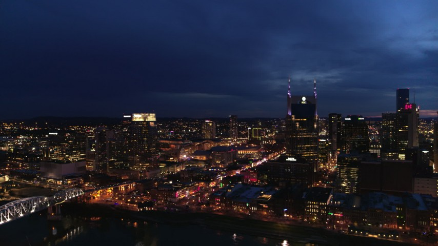 5.7K stock footage aerial video fly away from Pinnacle skyscraper and AT&T Building for view of Broadway at twilight, Downtown Nashville, Tennessee Aerial Stock Footage DX0002_121_008 | Axiom Images