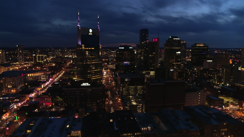 5.7K stock footage aerial video approach the city's skyline and AT&T Building from river at twilight, Downtown Nashville, Tennessee Aerial Stock Footage | DX0002_121_011