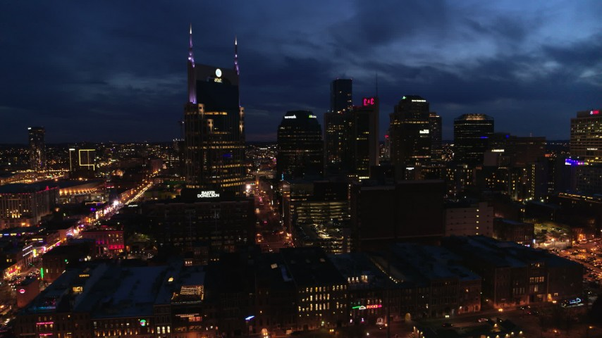 5.7K stock footage aerial video reverse view of AT&T Building and skyline at twilight, Downtown Nashville, Tennessee Aerial Stock Footage | DX0002_121_012