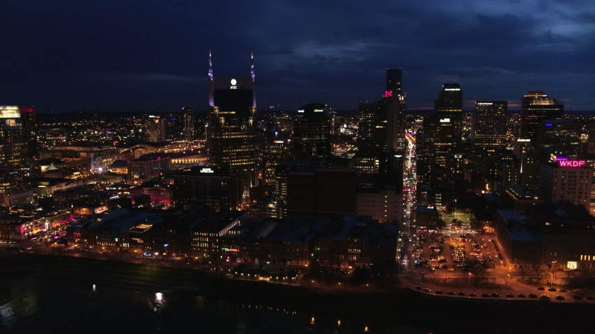 5.7K stock footage aerial video city skyline at twilight, cross river toward AT&T Building, Downtown Nashville, Tennessee Aerial Stock Footage | DX0002_121_014
