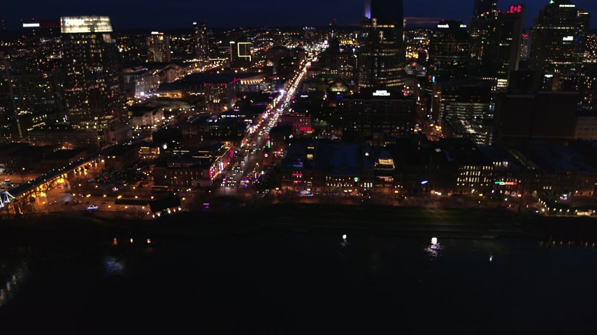 5.7K stock footage aerial video fly away from Broadway and traffic at twilight, reveal skyscrapers, Downtown Nashville, Tennessee Aerial Stock Footage | DX0002_121_018