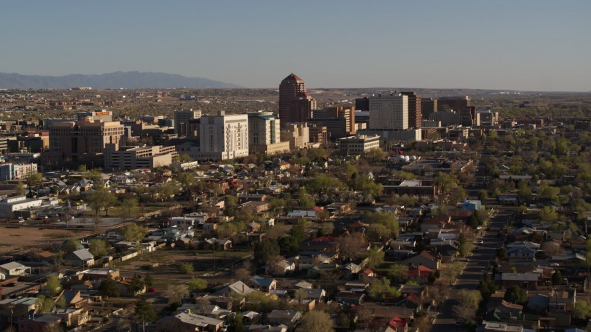 5.7K stock footage aerial video of the city's high-rises seen from residential neighborhoods in Downtown Albuquerque, New Mexico Aerial Stock Footage | DX0002_122_002