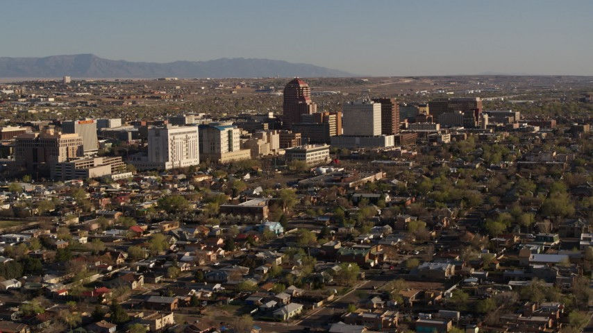 5.7K stock footage aerial video of the city's high-rises seen while ascending near residential neighborhoods in Downtown Albuquerque, New Mexico Aerial Stock Footage | DX0002_122_003