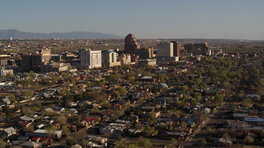 5.7K stock footage aerial video of flying by the city's high-rises seen from neighborhoods during descent, Downtown Albuquerque, New Mexico Aerial Stock Footage | DX0002_122_004