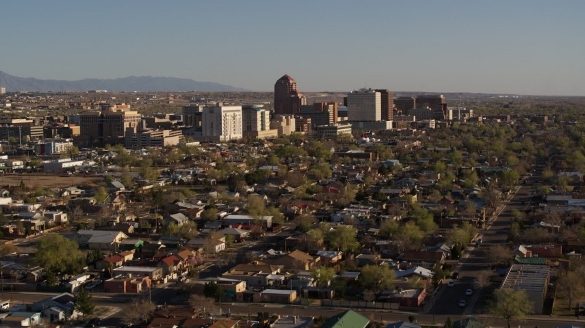 5.7K stock footage aerial video of the city's high-rises seen from neighborhoods during descent, Downtown Albuquerque, New Mexico Aerial Stock Footage | DX0002_122_005