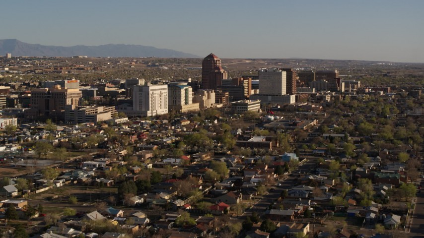 5.7K stock footage aerial video of approaching the city's high-rises from neighborhoods during ascent, Downtown Albuquerque, New Mexico Aerial Stock Footage | DX0002_122_006