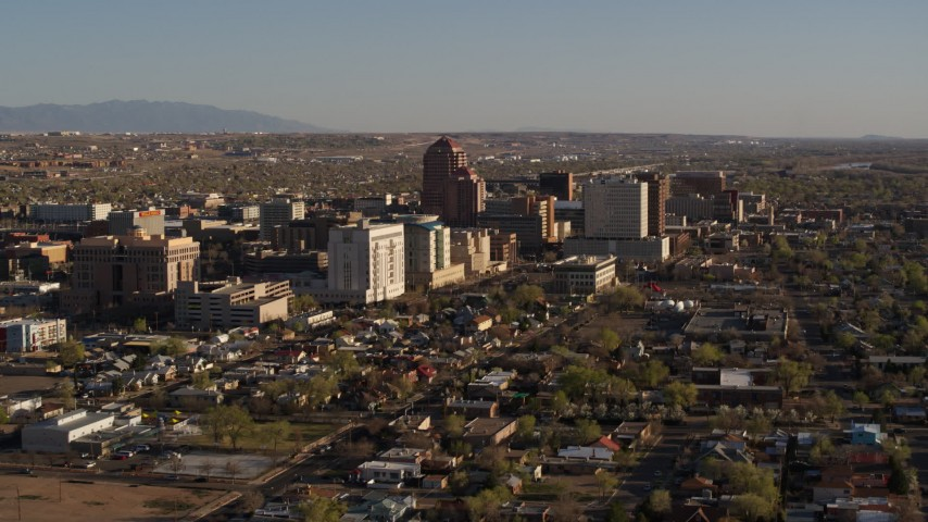 5.7K stock footage aerial video flyby and away from the city's high-rises, Downtown Albuquerque, New Mexico Aerial Stock Footage | DX0002_122_007