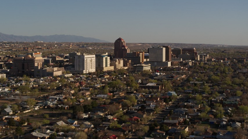5.7K stock footage aerial video of slowly passing by the city's high-rises, seen from neighborhoods, Downtown Albuquerque, New Mexico Aerial Stock Footage | DX0002_122_009