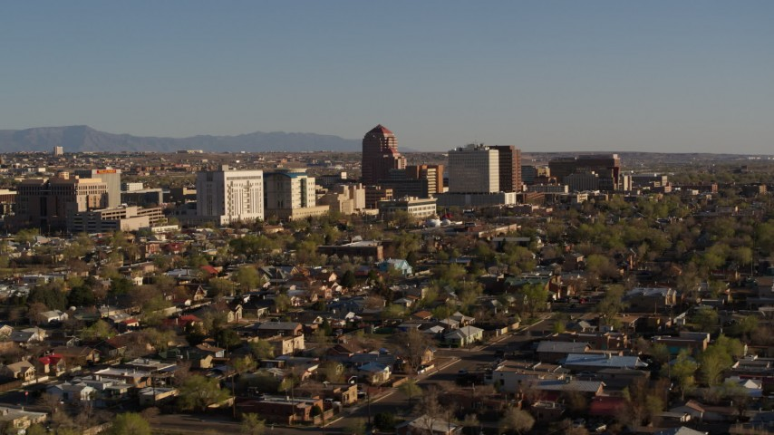 5.7K stock footage aerial video of slowly flying by the city's high-rises, seen from homes, Downtown Albuquerque, New Mexico Aerial Stock Footage   DX0002_122_010