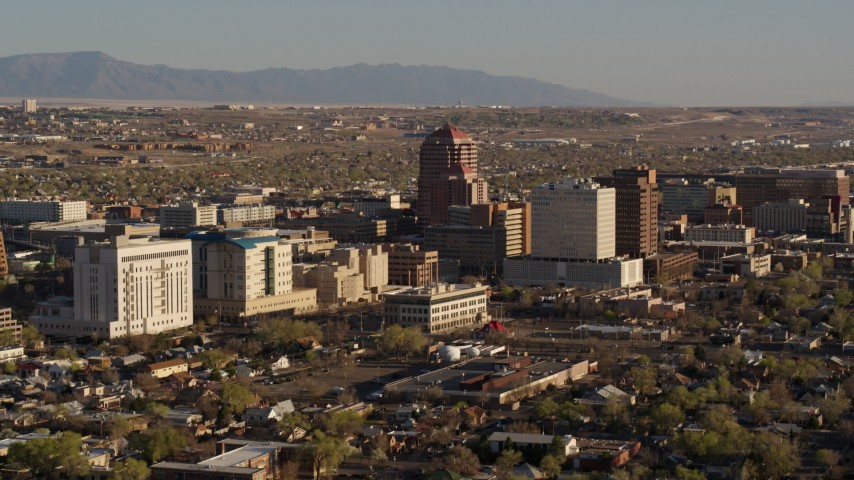 5.7K stock footage aerial video of approaching and passing the city's office high-rises, Downtown Albuquerque, New Mexico Aerial Stock Footage | DX0002_122_017