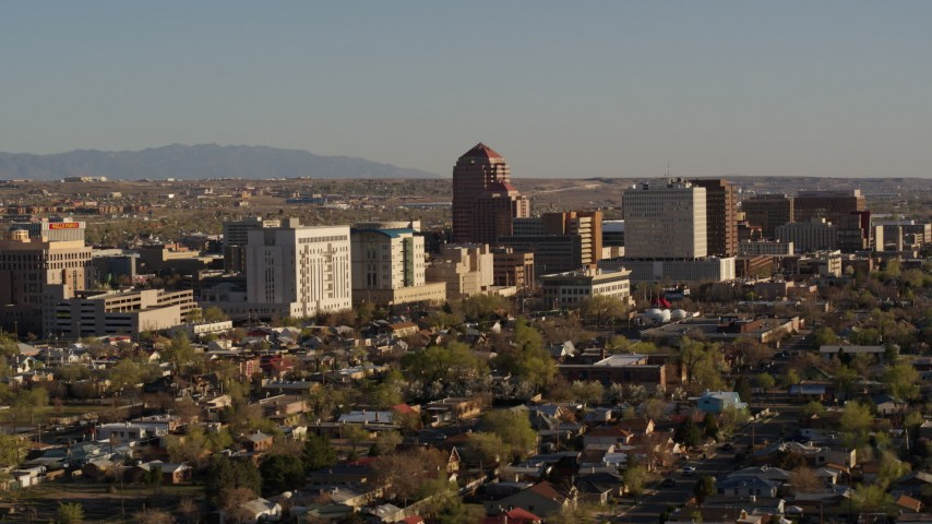 5.7K stock footage aerial video of flying by the office high-rise buildings in Downtown Albuquerque, New Mexico Aerial Stock Footage | DX0002_122_019