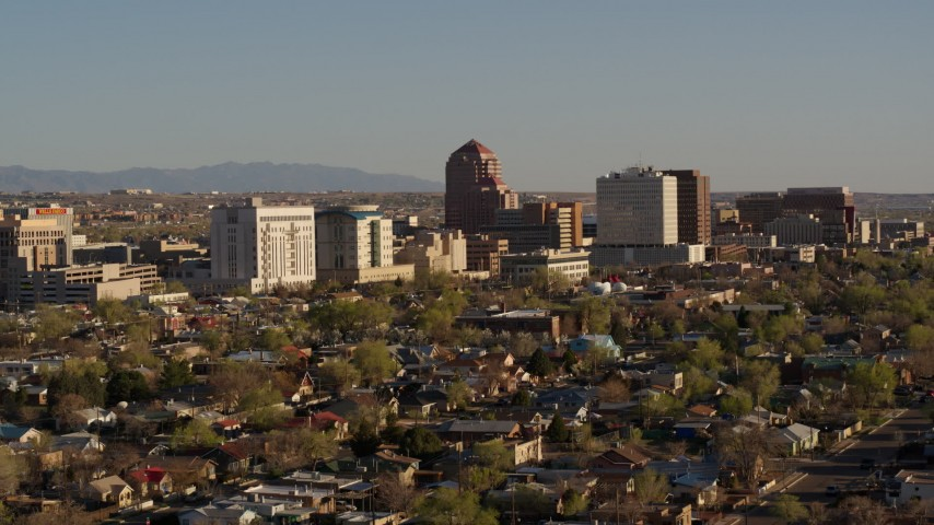 5.7K stock footage aerial video of passing the office high-rise buildings and descend in Downtown Albuquerque, New Mexico Aerial Stock Footage | DX0002_122_020