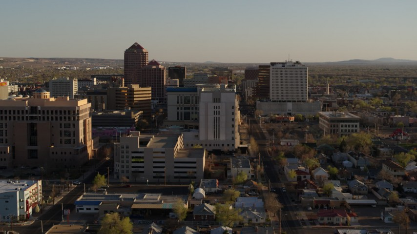 5.7K stock footage aerial video of flying by a courthouse and office high-rise buildings in Downtown Albuquerque, New Mexico Aerial Stock Footage | DX0002_122_021