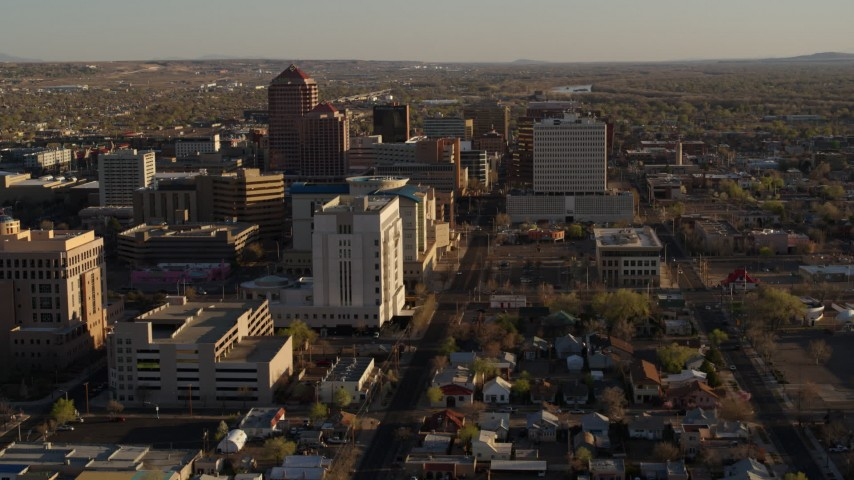 5.7K stock footage aerial video of flying by office high-rise buildings in Downtown Albuquerque, New Mexico Aerial Stock Footage | DX0002_122_022