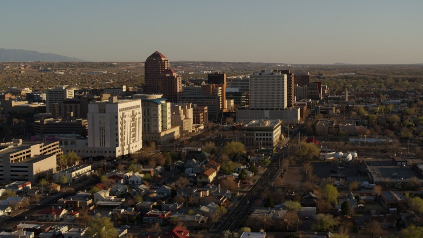 5.7K stock footage aerial video of passing by office high-rise buildings and ascend in Downtown Albuquerque, New Mexico Aerial Stock Footage | DX0002_122_023