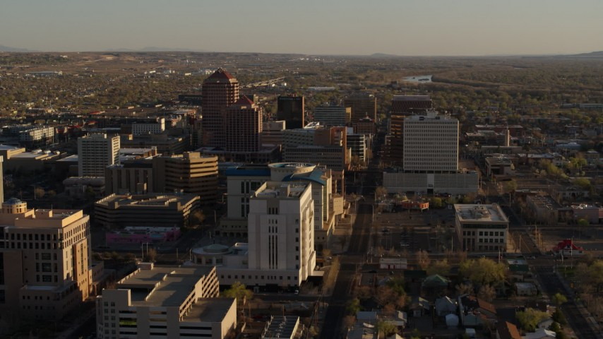 5.7K stock footage aerial video of flying by office high-rise buildings behind courthouse in Downtown Albuquerque, New Mexico Aerial Stock Footage | DX0002_122_024