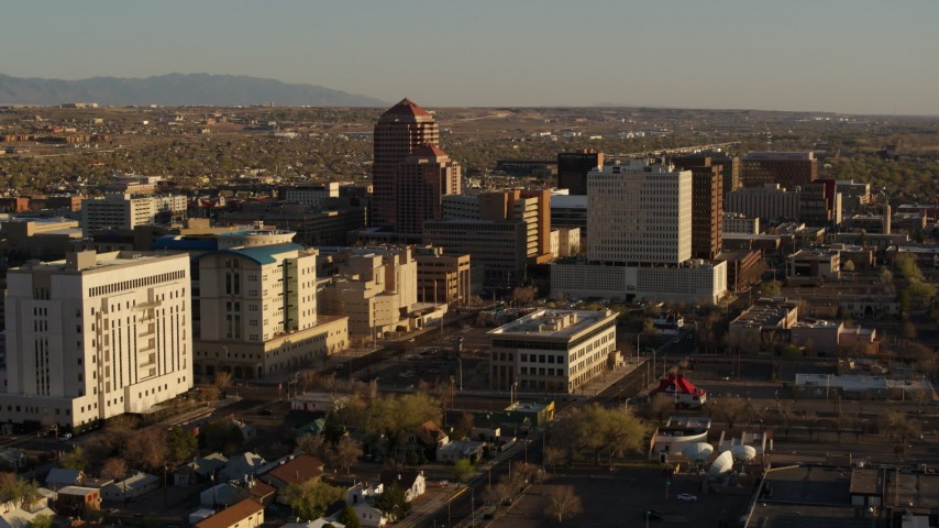 5.7K stock footage aerial video approach and pass high-rise office buildings in Downtown Albuquerque, New Mexico Aerial Stock Footage | DX0002_122_026