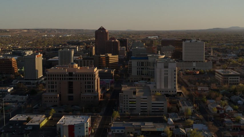 5.7K stock footage aerial video of a reverse view of office high-rise buildings in Downtown Albuquerque, New Mexico Aerial Stock Footage | DX0002_122_028