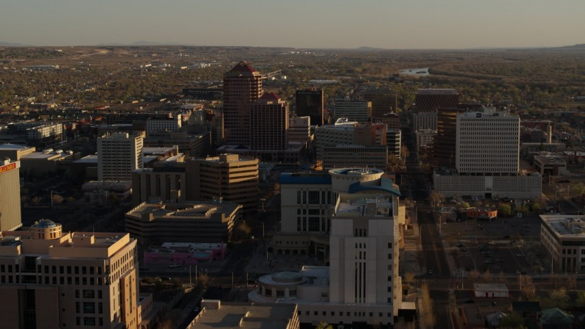 5.7K stock footage aerial video ascend near  courthouse for view of office high-rises in Downtown Albuquerque, New Mexico Aerial Stock Footage | DX0002_122_029