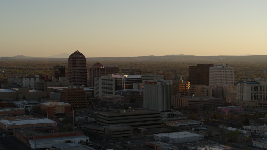 5.7K stock footage aerial video of high-rise office buildings at sunset during ascent in Downtown Albuquerque, New Mexico Aerial Stock Footage | DX0002_122_031