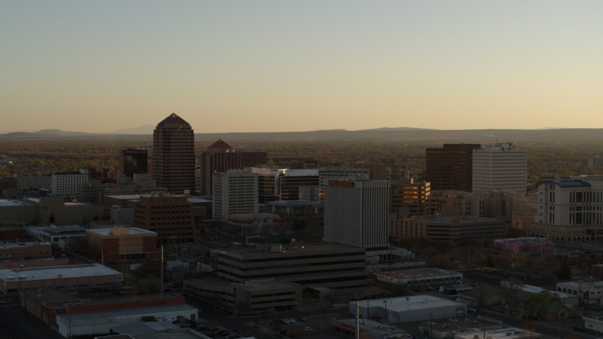 5.7K stock footage aerial video of a reverse view of high-rise office buildings at sunset, Downtown Albuquerque, New Mexico Aerial Stock Footage | DX0002_122_032