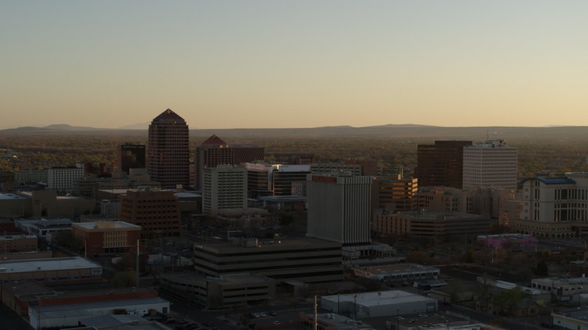 5.7K stock footage aerial video approach and flyby high-rise office buildings at sunset, Downtown Albuquerque, New Mexico Aerial Stock Footage | DX0002_122_033