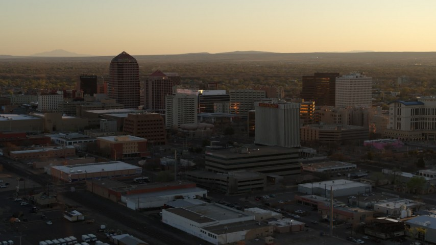 5.7K stock footage aerial video of slowly flying by high-rise office buildings at sunset, Downtown Albuquerque, New Mexico Aerial Stock Footage | DX0002_122_036