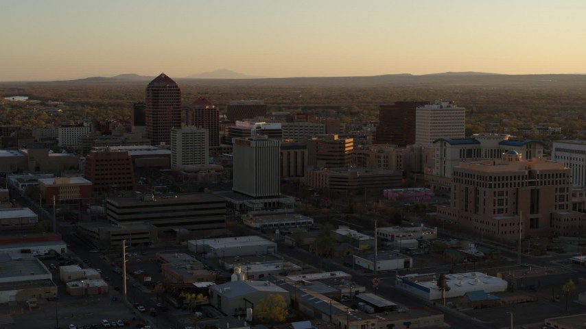 5.7K stock footage aerial video of slowly flying away from high-rise office buildings at sunset, Downtown Albuquerque, New Mexico Aerial Stock Footage | DX0002_122_037