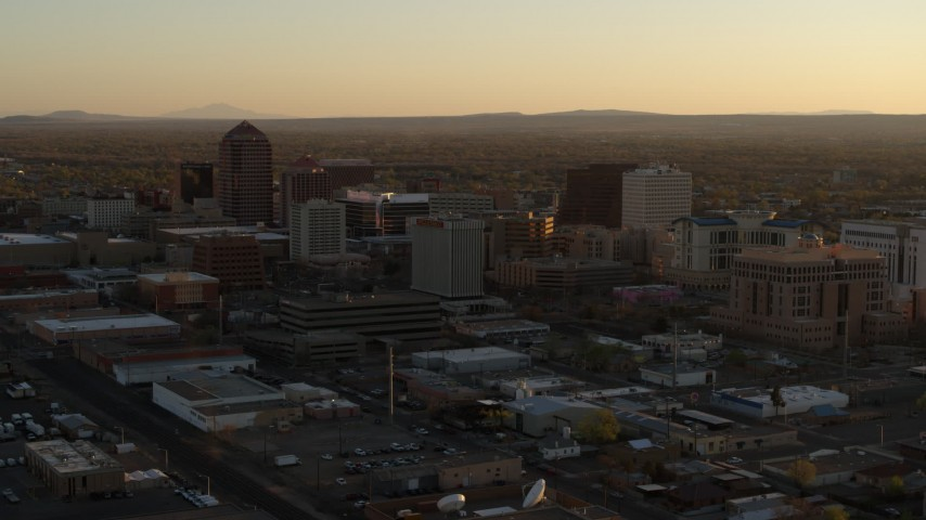 5.7K stock footage aerial video of slowly approaching high-rise office buildings at sunset, Downtown Albuquerque, New Mexico Aerial Stock Footage | DX0002_122_038
