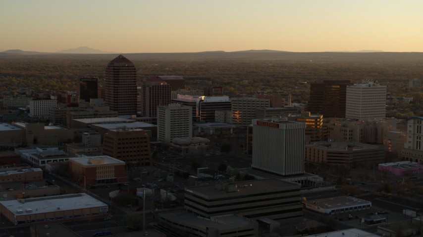 5.7K stock footage aerial video of slowly flying toward high-rise office buildings at sunset, Downtown Albuquerque, New Mexico Aerial Stock Footage | DX0002_122_039