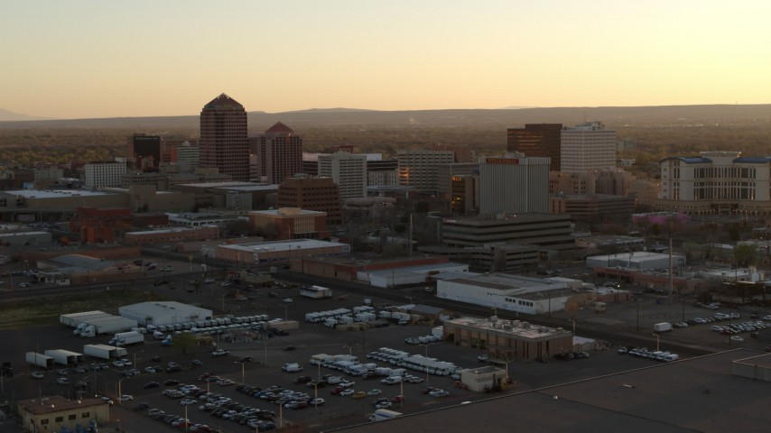 5.7K stock footage aerial video pass and then approach high-rise office buildings at sunset, Downtown Albuquerque, New Mexico Aerial Stock Footage | DX0002_122_044