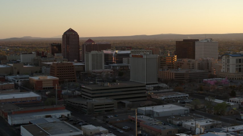 5.7K stock footage aerial video approach and then flyby office high-rises at sunset, Downtown Albuquerque, New Mexico Aerial Stock Footage | DX0002_122_045