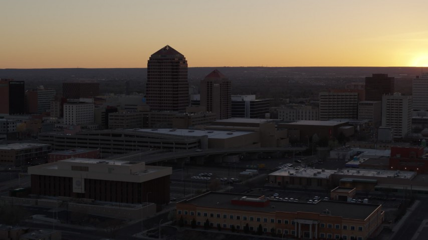 5.7K stock footage aerial video of an office tower and shorter hotel tower at sunset, Downtown Albuquerque, New Mexico Aerial Stock Footage | DX0002_122_047