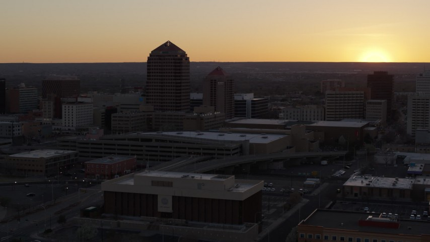 5.7K stock footage aerial video of orbiting an office tower and shorter hotel tower at sunset, Downtown Albuquerque, New Mexico Aerial Stock Footage | DX0002_122_048