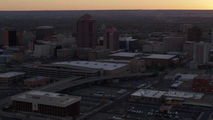 5.7K stock footage aerial video orbit office tower and shorter hotel tower behind convention center at sunset, Downtown Albuquerque, New Mexico Aerial Stock Footage | DX0002_122_051