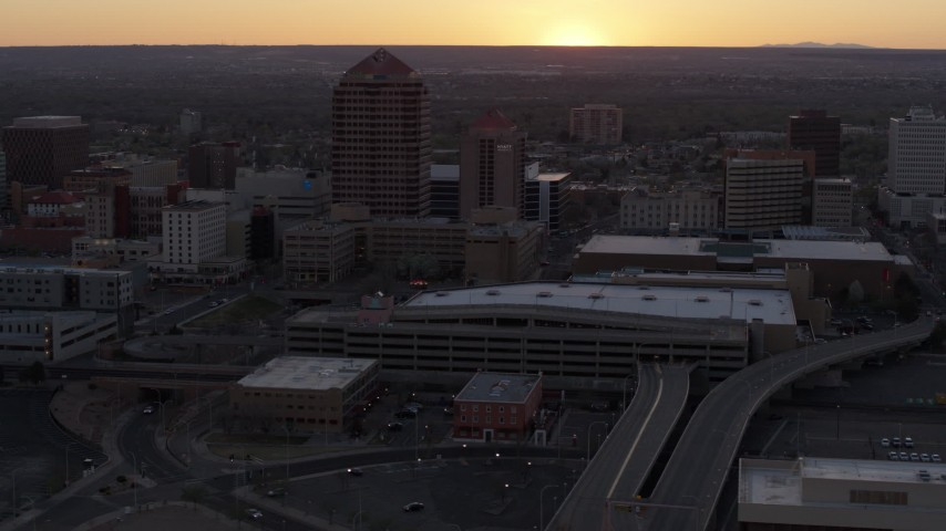 5.7K stock footage aerial video orbit office tower and shorter hotel tower behind convention center at sunset, Downtown Albuquerque, New Mexico Aerial Stock Footage | DX0002_122_052