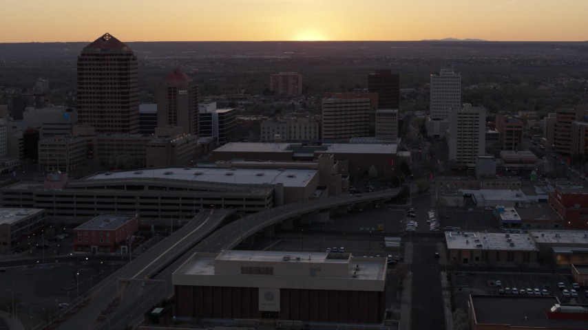 5.7K stock footage aerial video flyby office tower and shorter hotel tower behind convention center at sunset, Downtown Albuquerque, New Mexico Aerial Stock Footage | DX0002_122_053