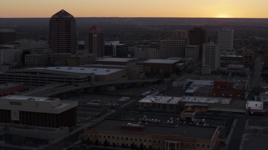 5.7K stock footage aerial video flyby office high-rises and convention center near office tower and shorter hotel tower at sunset, Downtown Albuquerque, New Mexico Aerial Stock Footage | DX0002_122_054