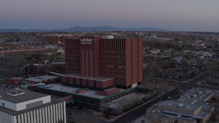 5.7K stock footage aerial video of approaching a hospital at sunset in Albuquerque, New Mexico Aerial Stock Footage | DX0002_123_001