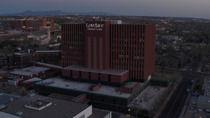 5.7K stock footage aerial video of an orbit of a hospital at sunset in Albuquerque, New Mexico Aerial Stock Footage | DX0002_123_004