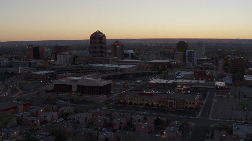 5.7K stock footage aerial video of office tower and hotel tower at sunset near office high-rises, Downtown Albuquerque, New Mexico Aerial Stock Footage DX0002_123_005 | Axiom Images